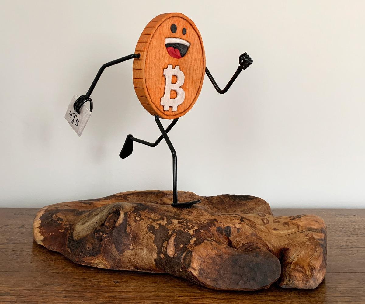 Running Bitcoin sculpture front